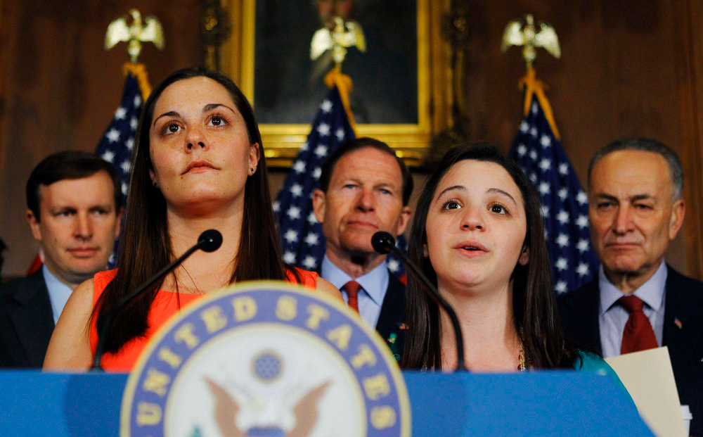 Description of . Erica Lafferty (L) and Jillian Soto (R), who both lost relatives in the Sandy Hook Elementary School shootings, attend a news briefing with (rear, L-R): Senators Christopher Murphy (D-CT), Richard Blumenthal (D-CT), and Charles Schumer (D-NY) in Washington April 11, 2013. The U.S. Senate cleared the way on Thursday for an emotional, weeks-long debate on proposals to curb gun violence, rejecting an effort by conservative Republicans to block consideration of gun-control legislation prompted by December\'s Newtown school massacre. REUTERS/Gary Cameron