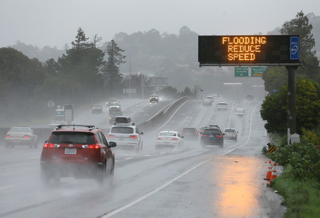 . A sign warns motorists of flooding on northbound Highway 101, Monday, Feb. 20, 2017, in Corte Madera, Calif. Heavy downpours are swelling creeks and rivers and bringing threats of flooding in California\'s already soggy northern and central regions. The National Weather Service map shows floods, snow and wind advisories for the northern part of the state.(AP Photo/Eric Risberg)