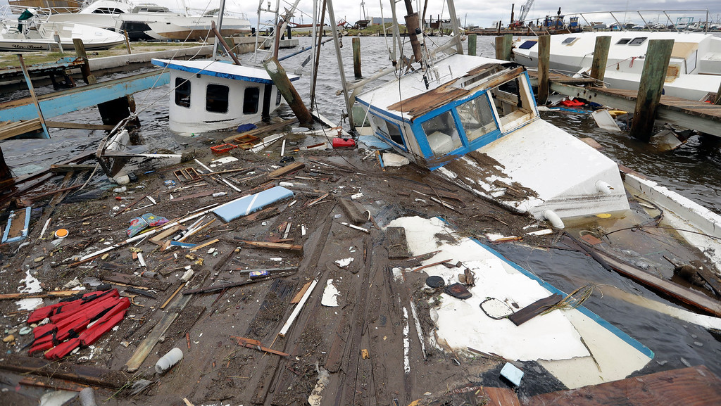. Boats that sunk in the wake of Hurricane Harvey are surrounded by floating debris Sunday, Aug. 27, 2017, in Rockport, Texas. (AP Photo/Eric Gay)