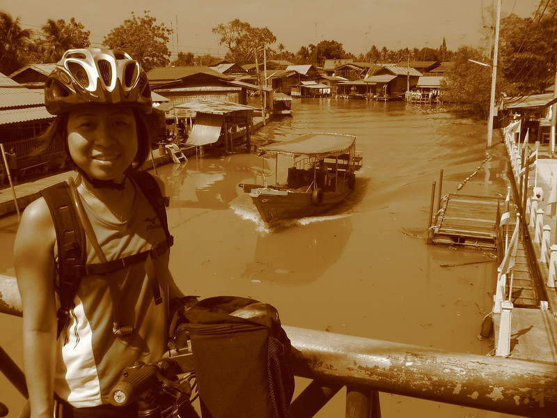 Going over a bridge at Amphawa Canal