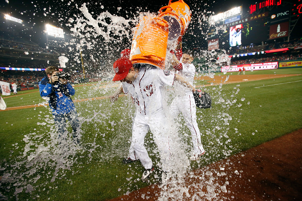 . Washington Nationals starting pitcher Max Scherzer is doused after the team\'s baseball game against the Detroit Tigers at Nationals Park, Wednesday, May 11, 2016, in Washington. Scherzer struck out 20 batters, tying the major league nine-inning record. The Nationals won 3-2. (AP Photo/Alex Brandon)