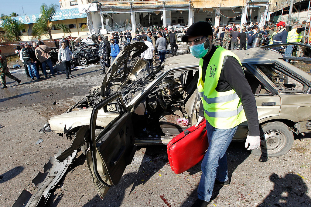 . Lebanese policemen and civilian defense members inspect the damaged cars at the site of explosion near the Kuwaiti Embassy and Iran\'s Chancellery center, in Beir Hassan area at southern suburbs of Beirut, Lebanon, 19 February 2014.  EPA/NABIL MOUNZER