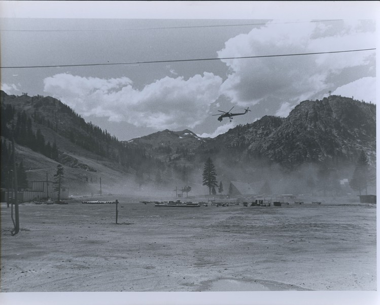 1976 - helicopter touching down in valley.jpeg