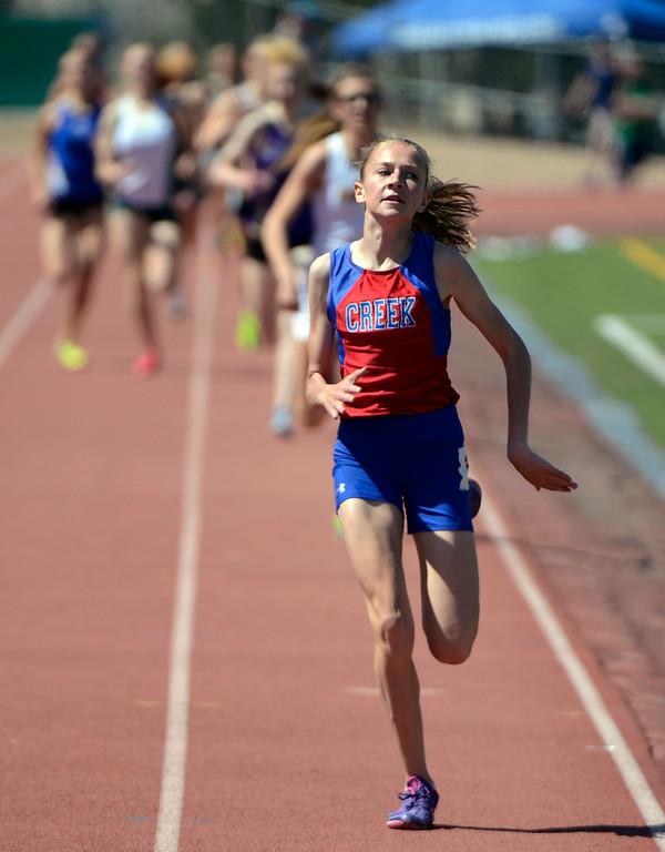 . LITTLETON, CO. - APRIL 27TH: Jordyn Colter, Cherry Creek High School,  leads other runners to the finish line to win the girls 800 meter race at the Liberty Bell Track Meet at Littleton Public Schools Stadium Saturday, April 27th, 2013.  (Photo By Andy Cross/The Denver Post)