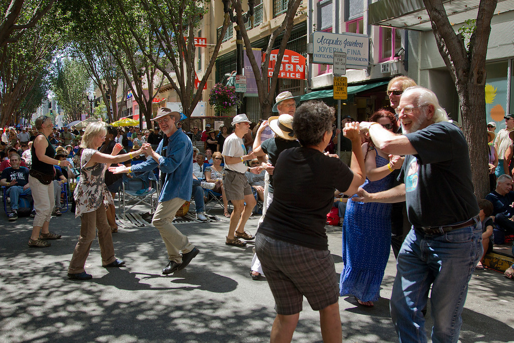 . Festival attendees dance near the Big Easy Stage at the San Jose Jazz Festival, in San Jose, Calif., on Saturday Aug. 10, 2013.  (LiPo Ching/Bay Area News Group)