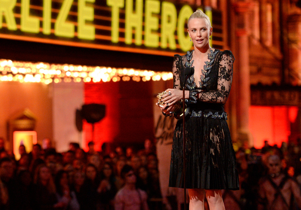 . Charlize Theron accepts the award for best female performance for �Mad Max: Fury Road� at the MTV Movie Awards at Warner Bros. Studio on Saturday, April 9, 2016, in Burbank, Calif. (Kevork Djansezian/Pool Photo via AP)
