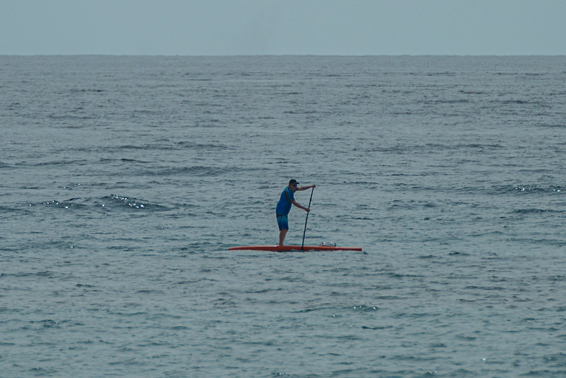 A man paddle boards off of Midtown Beach in Palm Beach, Sunday, June 28, 2020. [JOSEPH FORZANO/palmbeachpost.com]