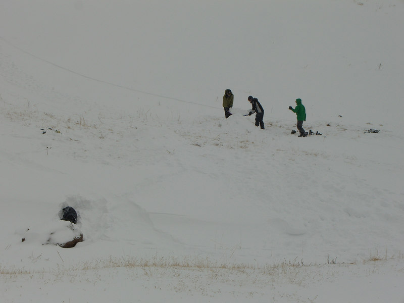 Yep - the Gnarly Boys are building a ski jump. [Kid napping in left foreground in snow shelter.]