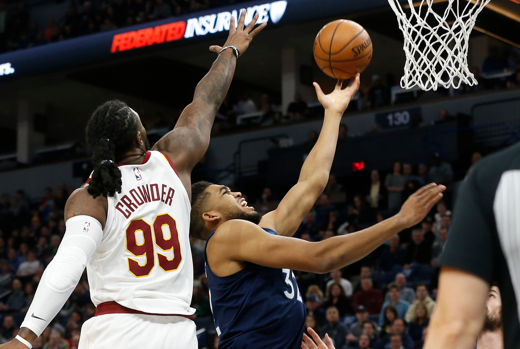 . Minnesota Timberwolves\' Karl-Anthony Towns, right, lays up as Cleveland Cavaliers\' Jae Crowder defends in the first half of an NBA basketball game Monday, Jan. 8, 2018, in Minneapolis. (AP Photo/Jim Mone)