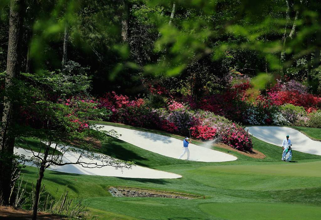 . K.J. Choi of Korea plays a bunker shot on the 13th hole during the final round of the 2014 Masters Tournament at Augusta National Golf Club on April 13, 2014 in Augusta, Georgia.  (Photo by David Cannon/Getty Images)