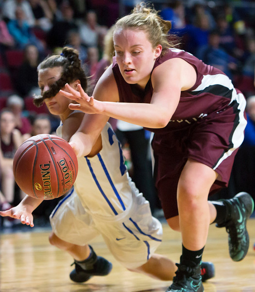 BANGOR, Maine -- 02/21/2017 -- Stearns' Emma Alley (left) dives for a loose ball against Narraguagus' Kylee Joyce during their Class C girls basketball quarterfinal game at the Cross Insurance Center in Bangor Tuesday. Ashley L. Conti | BDN