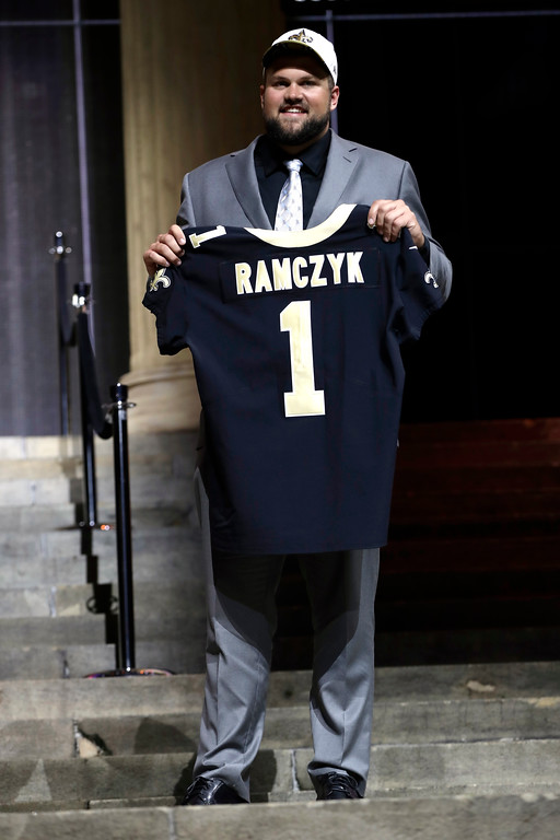 . Wisconsin\'s Ryan Ramczyk poses after being selected by the New Orleans Saints during the first round of the 2017 NFL football draft, Thursday, April 27, 2017, in Philadelphia. (AP Photo/Matt Rourke)