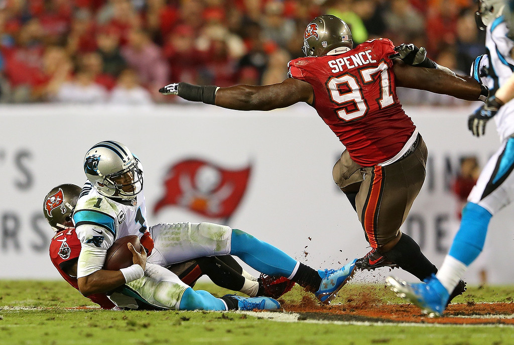 . Cam Newton #1 of the Carolina Panthers is sacked by Johnthan Banks #27 of the Tampa Bay Buccaneers during a game  at Raymond James Stadium on October 24, 2013 in Tampa, Florida.  (Photo by Mike Ehrmann/Getty Images)