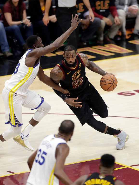 . Cleveland Cavaliers\' LeBron James goes to the basket against Golden State Warriors\' Draymond Green in the second half of Game 3 of basketball\'s NBA Finals, Wednesday, June 6, 2018, in Cleveland. (AP Photo/Tony Dejak)