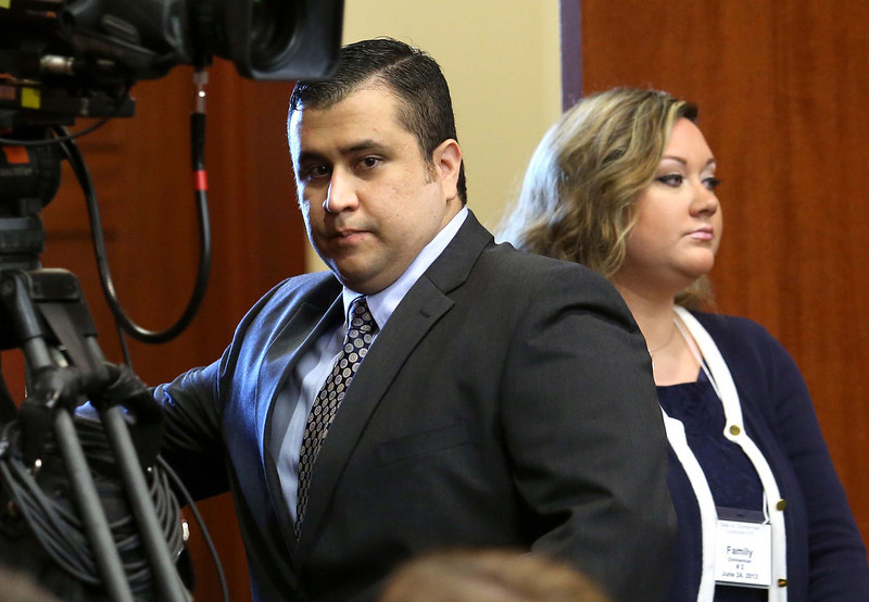. George Zimmerman, left, arrives in Seminole circuit court with his wife, Shellie, on the 11th day of his trial, in Sanford, Fla., Monday, June 24, 2013. Zimmerman is accused in the fatal shooting of Trayvon Martin. Zimmerman has been charged with second-degree murder for the 2012 shooting death of Trayvon Martin. (AP Photo/Orlando Sentinel, Joe Burbank, Pool)