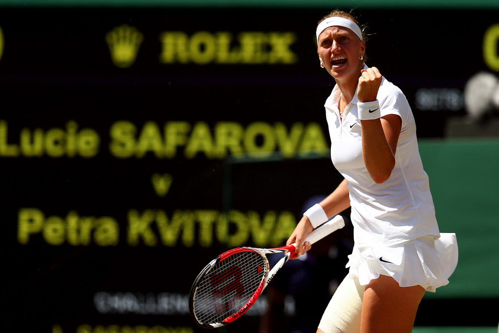 . Petra Kvitova of Czech Republic celebrates during her Ladies\' Singles semi-final match against Lucie Safarova of Czech Republic on day ten of the Wimbledon Lawn Tennis Championships at the All England Lawn Tennis and Croquet Club  on July 3, 2014 in London, England.  (Photo by Clive Brunskill/Getty Images)