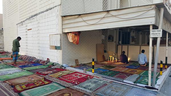 Street-side prayers, in Manama, Bahrain