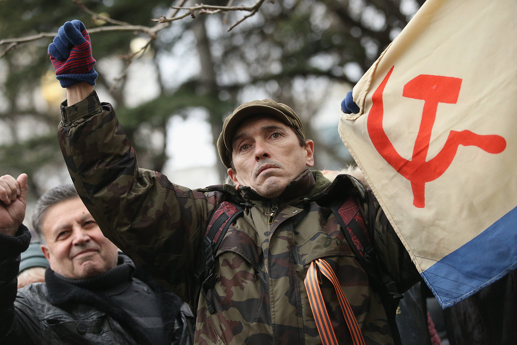 . Pro-Russian supporters rally outside the Crimean parliament building on February 28, 2014 in Simferopol, Ukraine. According to media reports Russian soldiers have occupied the airport at nearby Sevastapol while soldiers whose identity could not be initially confirmed have stationed themselves at Simferopol International Airport in moves that are raising tensions between Russia and the new Kiev government. Crimea has a majority Russian population and armed, pro-Russian groups have occupied government buildings in Simferopol.  (Photo by Sean Gallup/Getty Images)