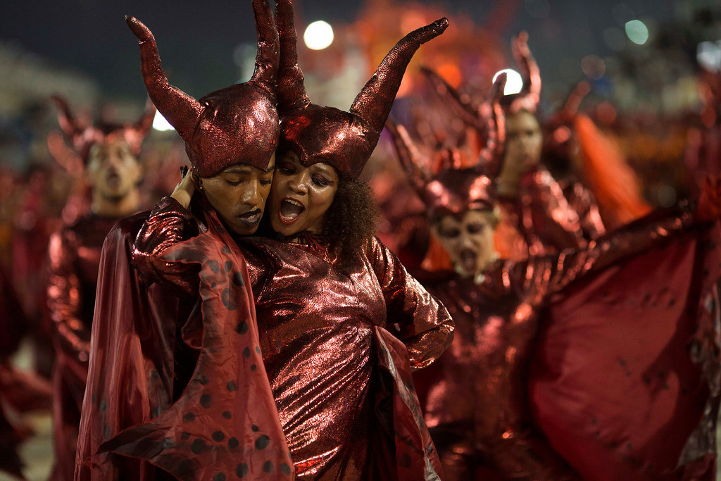. Performers from the Salgueiro samba school dance together during Carnival celebrations at the Sambadrome in Rio de Janeiro, Brazil, Monday, Feb. 27, 2017. (AP Photo/Mauro Pimentel)