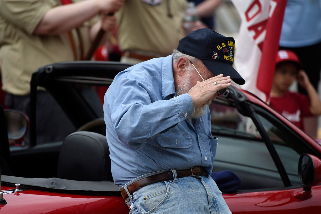 . Kayla Rice/Reformer Air Force veteran Dwight Blossom salutes during the raising of the flag at the Hinsdale VFW after the Hinsdale Memorial Day parade on Monday morning.