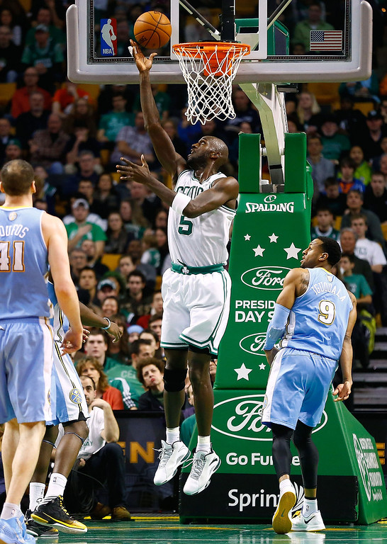. BOSTON, MA - FEBRUARY 10: Kevin Garnett #5 of the Boston Celtics takes a shot over Andre Iguodala #9 of the Denver Nuggets during the game on February 10, 2013 at TD Garden in Boston, Massachusetts.  (Photo by Jared Wickerham/Getty Images)