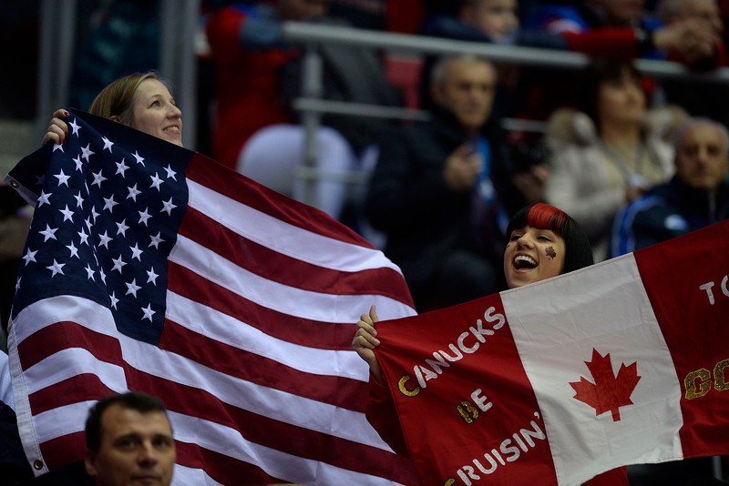 . Fans cheer during the first period of the women\'s gold medal ice hockey game. Sochi 2014 Winter Olympics on Thursday, February 20, 2014 at Bolshoy Ice Arena. (Photo by AAron Ontiveroz/ The Denver Post)