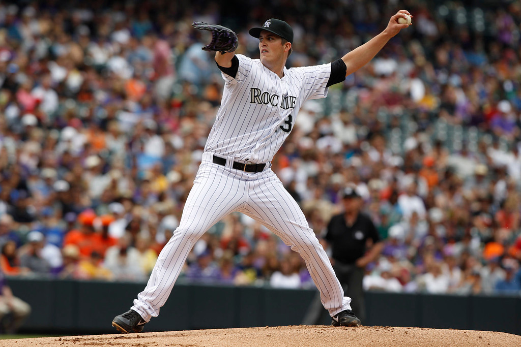 . Colorado Rockies starting pitcher Drew Pomeranz works against the San Francisco Giants in the first inning of a baseball game in Denver on Sunday, June 30, 2013.  (AP Photo/David Zalubowski)