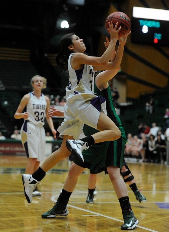. FT. COLLINS, CO. - MARCH 16TH:  Katie Chavez, left, Holy Family, goes up for a shot against Sarah Burns, St. Mary\'s in the first half of play during the 3A Colorado High School Basketball Championship game at Moby Arena in Ft. Collins Saturday evening, March 16th, 2013. (Photo By Andy Cross/The Denver Post)