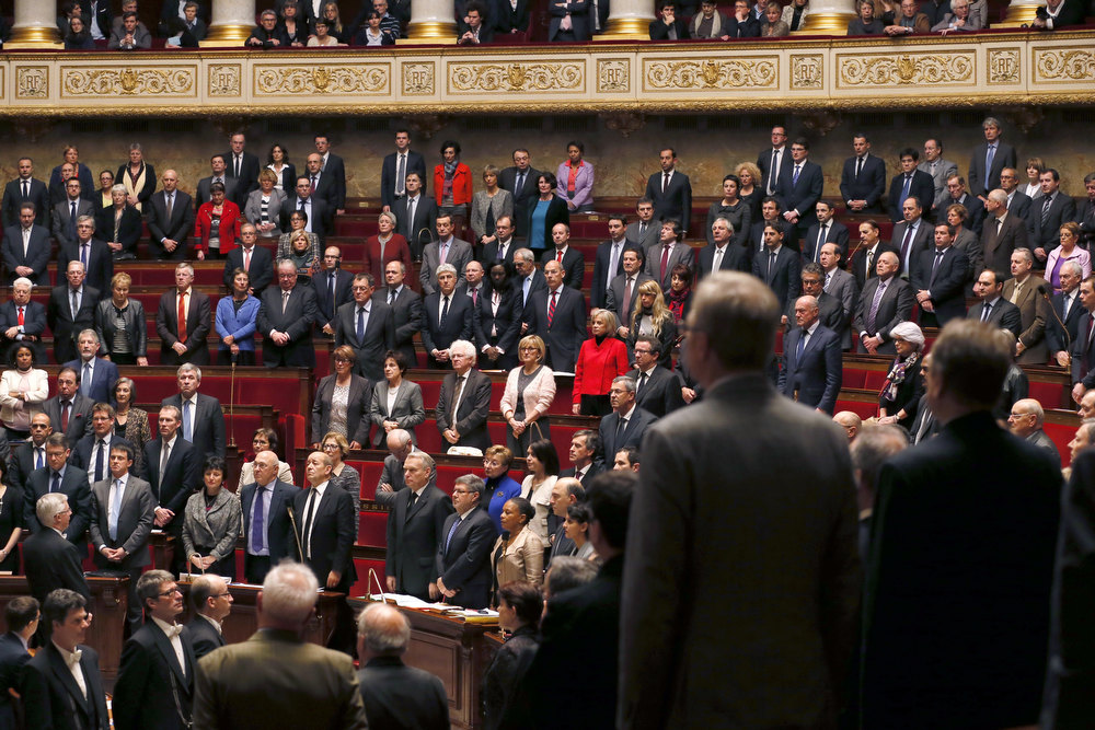 . France\'s deputies and government members observe a minute of silence in memory of French air force lieutenant Damien Boiteux, who died on January 11 during a helicopter raid launched to support Mali ground troops in the battle for the key town of Kona, during a session of questions to the government on January 15, 2013 at the French National Assembly in Paris. PATRICK KOVARIK/AFP/Getty Images