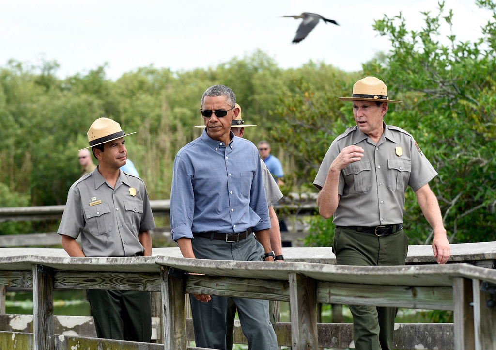 ". President Barack Obama walks the Anhinga Trail at Everglades National Park, Fla., Wednesday, April 22, 2015. Obama visited the Everglades on Earth Day to talk about how global warming threatens the U.S. economy. He says rising sea levels are putting the ""economic engine for the South Florida tourism industry\"" at risk. (AP Photo/Susan Walsh)"