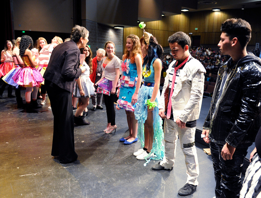 . As one of the judges for their creations, Suzanne Larson from His and Her Formal Wear in Brentwood speaks with students about their outfits  at the third annual Paper Skirt Fashion Show held at Liberty High School in Brentwood, Calif.  on Tuesday, Jan. 29, 2013.   (Susan Tripp Pollard/Staff)
