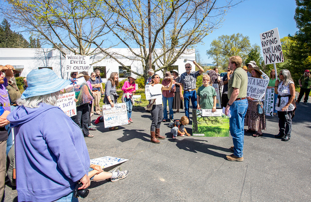 . Photo by Steve Eberhard TWN 12 Willits bypass protesters April 23, 2013 in front of the Willits CalTrans bypass project office at corner of Baechtel and E. Hill roads.