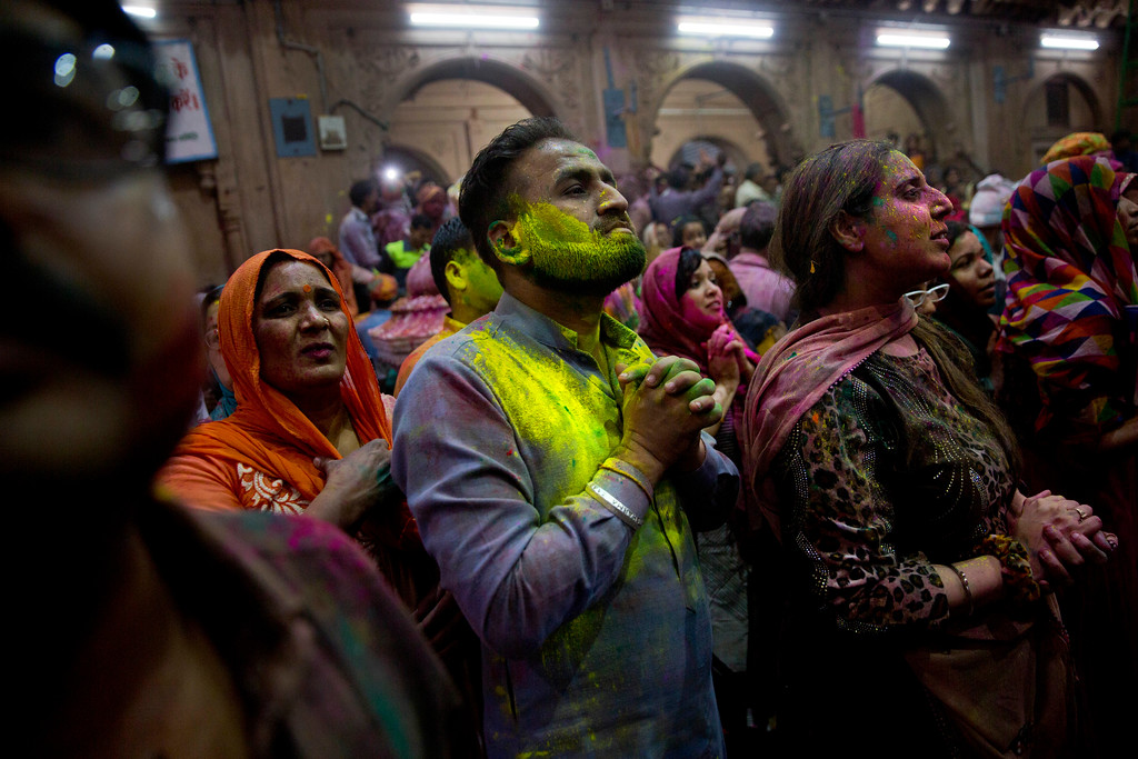 . Hindu devotees smeared in colors pray inside Banke Bihari temple during Holi festival celebrations in Vrindavan, India, Wednesday, March 8, 2017. Holi, the festival of colors celebrates the arrival of spring among other things. (AP Photo/Manish Swarup)