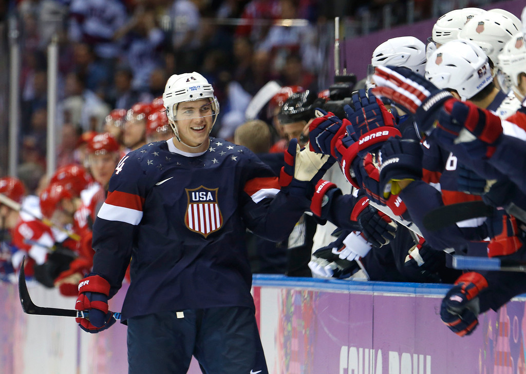 . USA forward T.J. Oshie is greeted by treammates after scoring a goal during a shootout against Russia in overtime of a men\'s ice hockey game at the 2014 Winter Olympics, Saturday, Feb. 15, 2014, in Sochi, Russia. (AP Photo/Mark Humphrey)