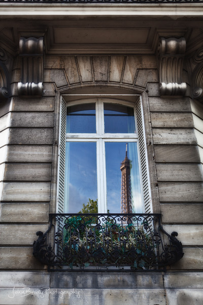 An Old Stone Building in Paris Holds the Reflection of the Eiffel Tower  - JohnBrody.com / John Brody Photography
