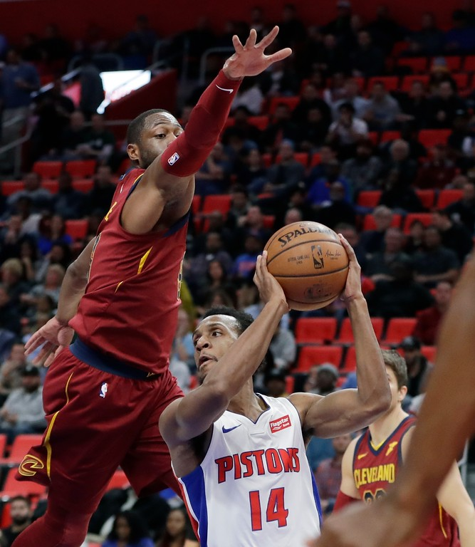 . Cleveland Cavaliers guard Dwyane Wade reaches as Detroit Pistons guard Ish Smith (14) tries to pass during the first half of an NBA basketball game, Monday, Nov. 20, 2017, in Detroit. (AP Photo/Carlos Osorio)