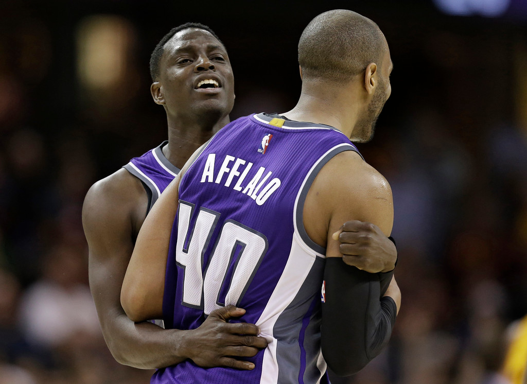 . Sacramento Kings\' Darren Collison, left, hugs Arron Afflalo after Afflalo hit a 3-point shot in overtime during the team\'s NBA basketball game against the Cleveland Cavaliers, Wednesday, Jan. 25, 2017, in Cleveland. The Kings won 116-112. (AP Photo/Tony Dejak)