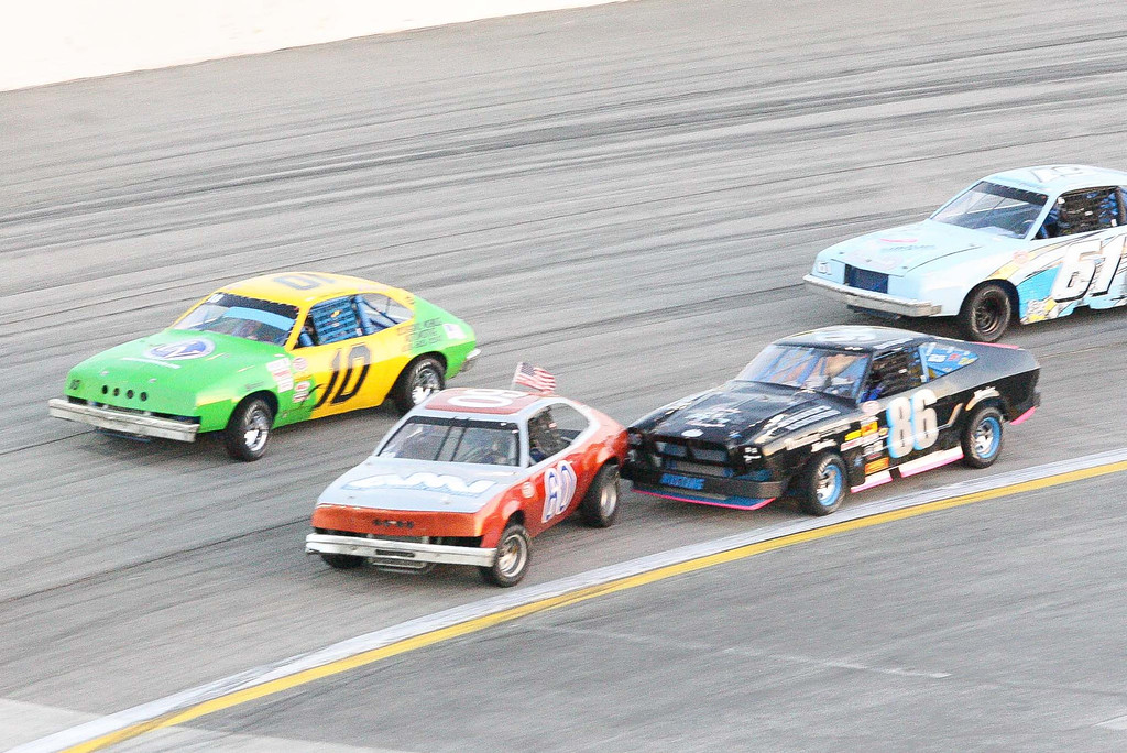 . Ryan Bragdon (86) bumps Kevin Bernharc (60) in the mini stock race opening night of racing at Irwindale Speedway Saturday April 6, 2013. (Correspondent photo by Chris Burt)