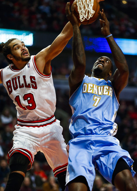 . Denver Nuggets center J.J. Hickson (R) and Chicago Bulls center Joakim Noah (L) battle for a rebound in the first half of their NBA game at the United Center in Chicago, Illinois, USA, 21 February 2014  EPA/TANNEN MAURY
