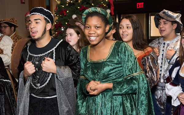 12/18/18 Wesley Bunnell | Staff The New Britain High School Madrigal Singers visited 1 Liberty Square on Tuesday afternoon to perform. Manuel Benitez and Kimberly Holder.
