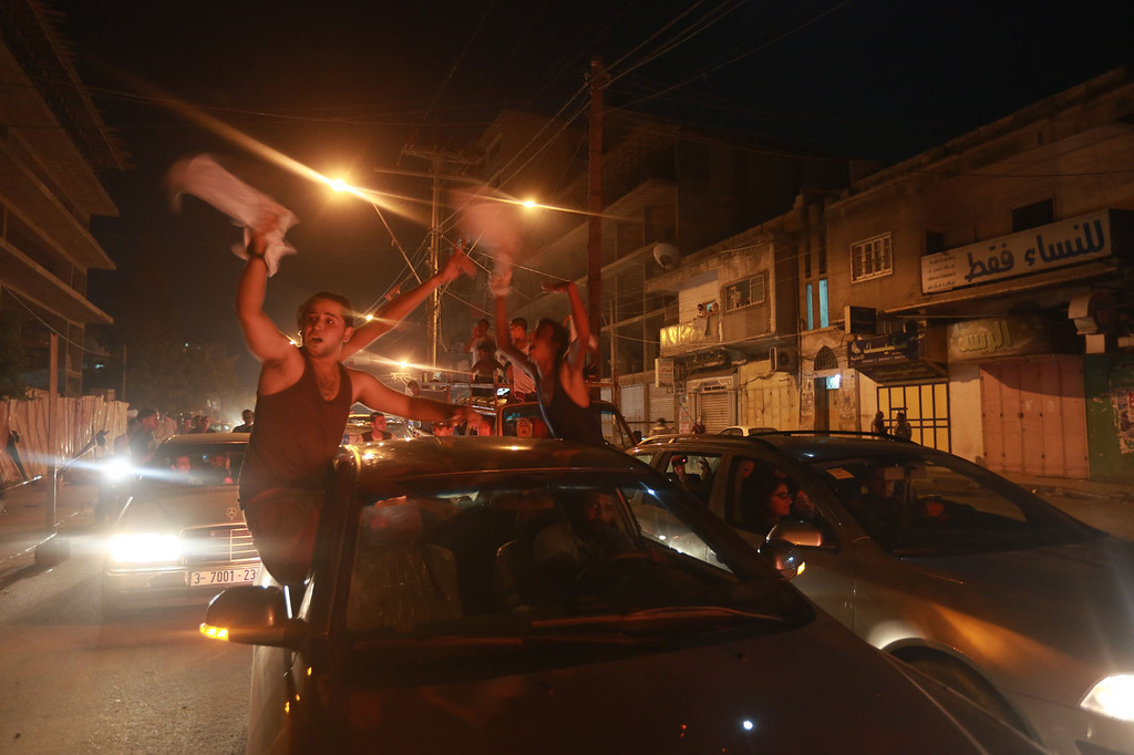". People celebrate Palestinian singer Mohammed Assaf winning ""Arab Idol\"" in Gaza city on June 22, 2013. The 22-year-old Assaf, from the Gaza Strip, was named the winner of \""Arab Idol\"" in a TV talent contest in Beirut.  MOHAMMED ABED/AFP/Getty Images"