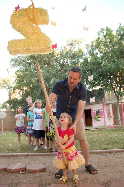 Pinata time!  I filled it with bags of lollipops and bubbles, two of Niamh's favorite things.  And, happily, heat-tollerant.