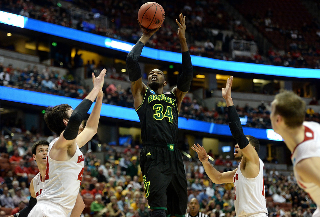 . Cory Jefferson #34 of the Baylor Bears shoots over Frank Kaminsky #44 of the Wisconsin Badgers in the first half during the regional semifinal of the 2014 NCAA Men\'s Basketball Tournament at the Honda Center on March 27, 2014 in Anaheim, California.  (Photo by Harry How/Getty Images)