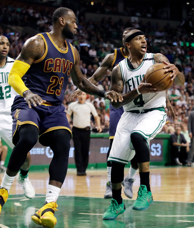 . Boston Celtics guard Isaiah Thomas (4) looks to pass away from the defense of Cleveland Cavaliers forward LeBron James (23) during the second quarter of Game 2 of the NBA basketball Eastern Conference finals,, Friday, May 19, 2017, in Boston. (AP Photo/Elise Amendola)