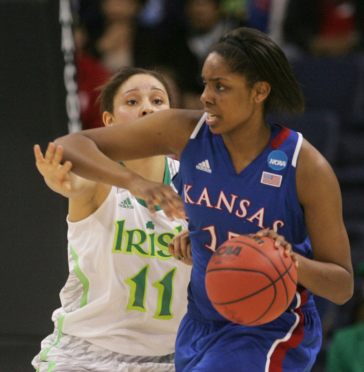. Kansas forward Chelsea Gardner (15) tries to fend off Notre Dame forward Natalie Achonwa (11) during the first half a regional semi-final of the NCAA college basketball tournament Sunday, March31, 2013, in Norfolk, Va.  (AP Photo/Jason Hirschfeld)