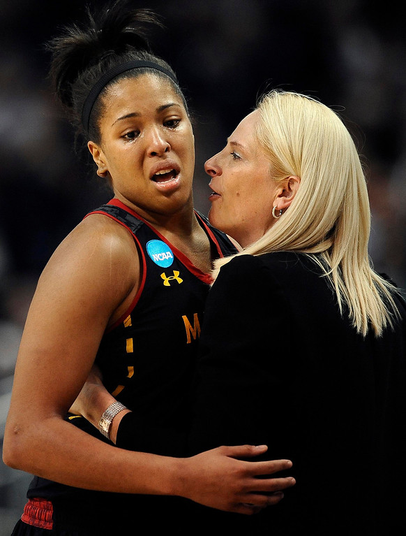 . Maryland\'s Tianna Hawkins, left, is consoled by Maryland head coach Brenda Frese during the final minutes of a regional semifinal game in the NCAA college basketball tournament in Bridgeport, Conn., Saturday, March 30, 2013. Connecticut won 76-50. (AP Photo/Jessica Hill)