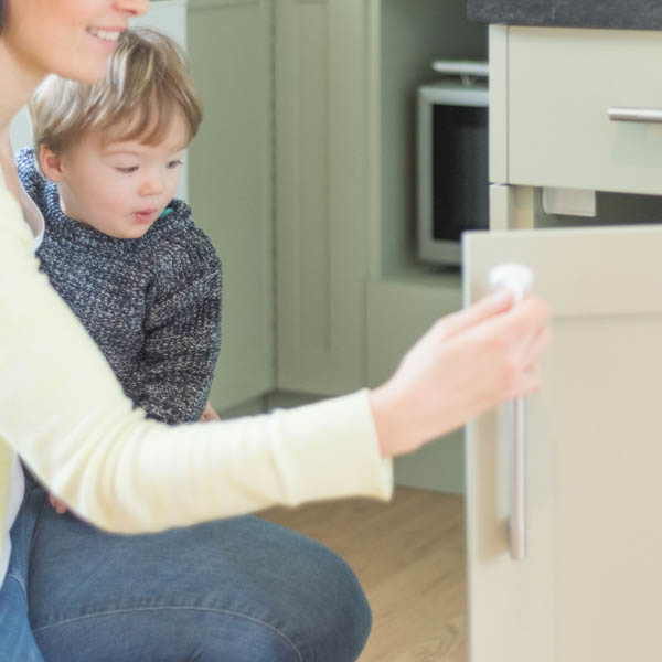 Fred_Home_Safety_Invisible_Magnet_Lock_Lifestyle_white_toddler.jpg