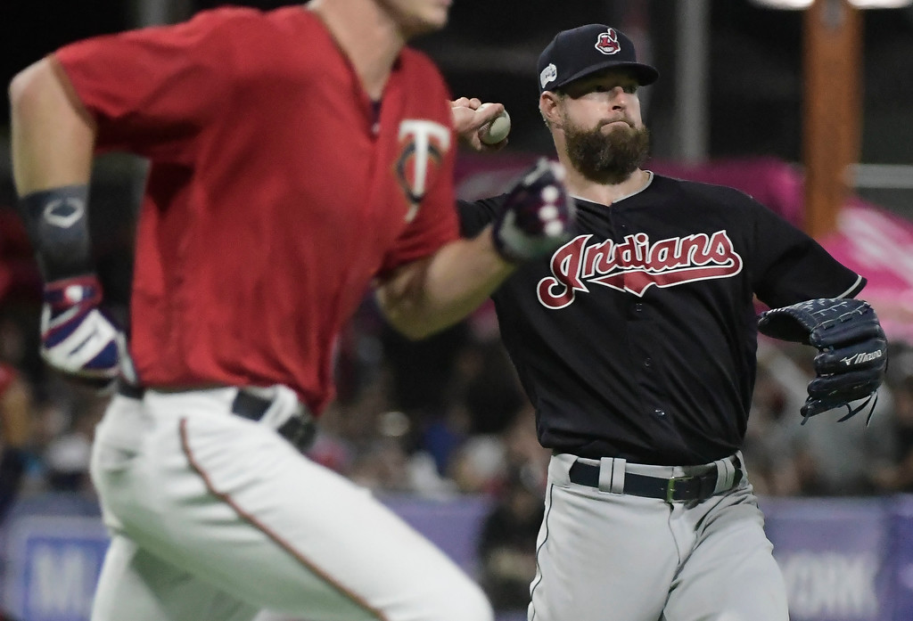 . CORRECTS CINCINNATI TO CLEVELAND - Cleveland Indians pitcher Corey Kluber throws to first during the fourth inning of game one of a two-game MLB Series against the Minnesota Twins at Hiram Bithorn Stadium in San Juan, Puerto Rico, Monday, April 17, 2018. (AP Photo/Carlos Giusti)