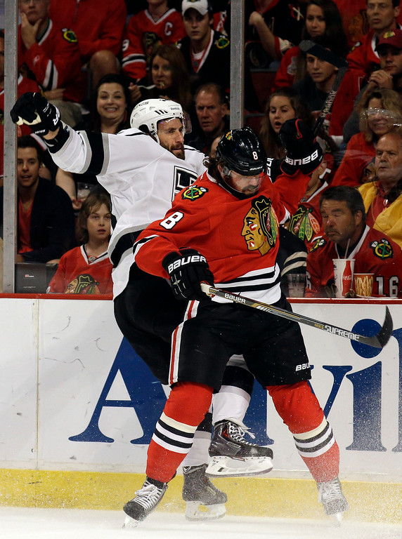 . Los Angeles Kings center Jarret Stoll, left, and  Chicago Blackhawks defenseman Nick Leddy (8) collide during the first period in Game 7 of the Western Conference finals in the NHL hockey Stanley Cup playoffs Sunday, June 1, 2014, in Chicago. (AP Photo/Nam Y. Huh)