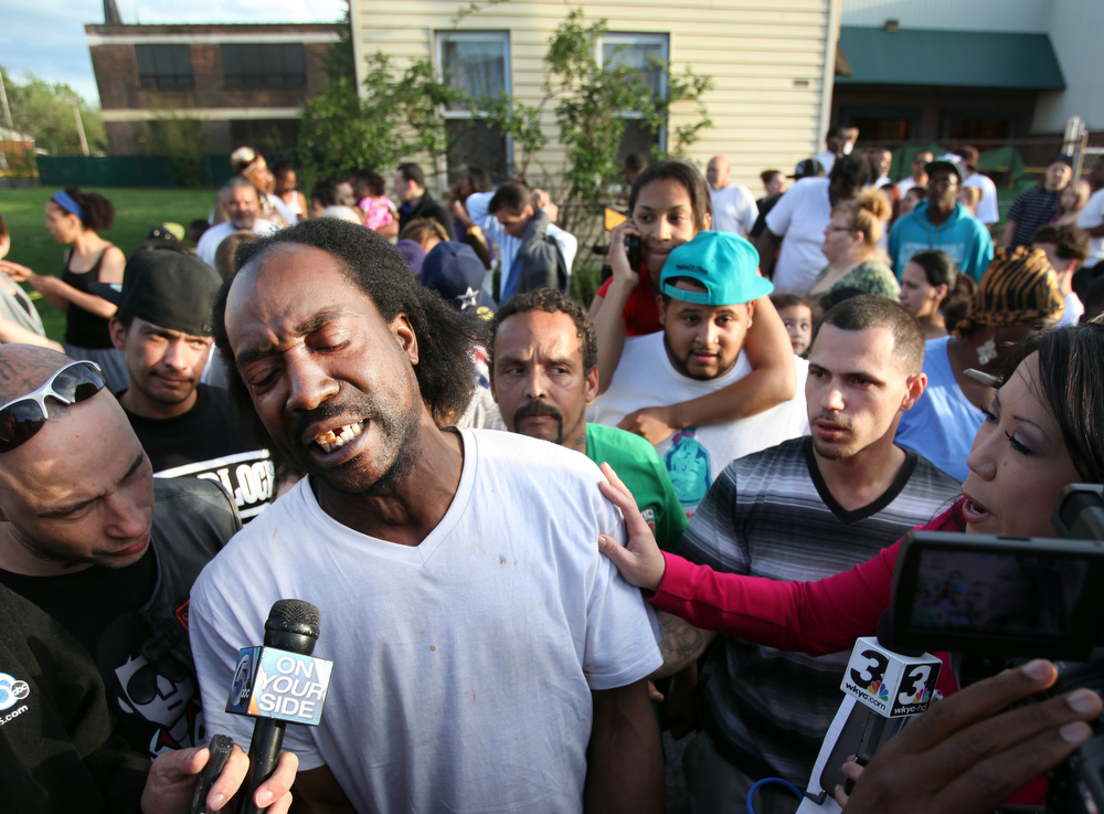 . Neighbor Charles Ramsey speaks to media near the home on the 2200 block of Seymour Avenue, where three missing women were rescued in Cleveland, on Monday, May 6, 2013. Cheering crowds gathered on the street where police said Amanda Berry, Gina DeJesus and Michele Knight, who went missing about a decade ago and were found earlier in the day. (AP Photo/The Plain Dealer, Scott Shaw)